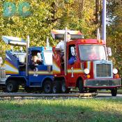 "A couple of truckers wave during a mini convoy. ""10-4"" ""Good Buddy!!"""