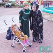 Three kids are dressed up for the Six Flags Fright Fest.