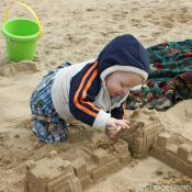Baby Luke making his first sand castle
