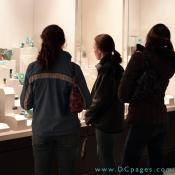 Visitors view the many dazzling gemstones displayed in the museum.