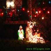 Three Wise Men and a lighted reindeer.