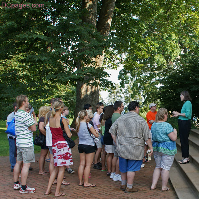 Visitors at Monticello listen to a docent