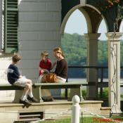 A mother sits with her two boys overlooking the Potomac River - Mount Vernon Estate