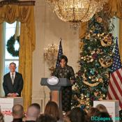 First Lady next to White House Christmas tree