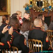 U.S. Marines and family members listen to Michelle Obama