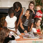Mrs. Obama helps to make a recycled Christmas Tree in the White House