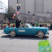 Linda Crop, Chair of DC Council waves to crowd watching the St Patricks Day parade.