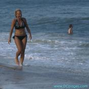 Ocean City - This woman takes a leisurely stroll down the beach at Ocean City.