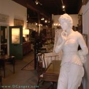 Onslow Square Antiques - A peak into the front of the store, lends a view of what is to come. Marble and bronze statuary, banquet tables for the more formal dining rooms. Rich dark woods that speak of elegance.