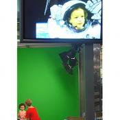 This little girl is having a astronauts image superimposed over her cute image.