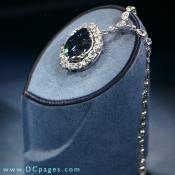 In the pendant surrounding the Hope diamond are 16 white diamonds, both pear-shapes and cushion cuts.