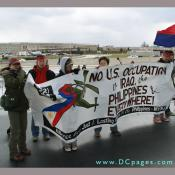 Filipinos group hold up sign - NO U.S. OCCUPATION in IRAQ, the PHILIPPINES & EVERYWHERE!