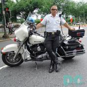 One of DC finest, riding a  Harley Davidson Police Special.