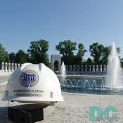 The hard hat of Friedrich St. Florian, World War II Memorial Design Architect. In the background the Memorial Plaza and Rainbow Pool are the principal design features of the Memorial, unifying all other elements.