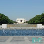West to East View of the World War II Memorial. 4,000 sculpted gold stars on the Freedom Wall. Lincoln Memorial in the background.