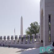 "East to West view of granite pillars celebrating the unprecedented unity of the nation during WWII. Special thanks to Bob Hovas, WWII veteran and the second public visitor to the Memorial for pointing out this shot. ""When you see the flag furling in the wind moving around the names of all the parts of our country embodied in one place, gives one a great feeling of unity."""