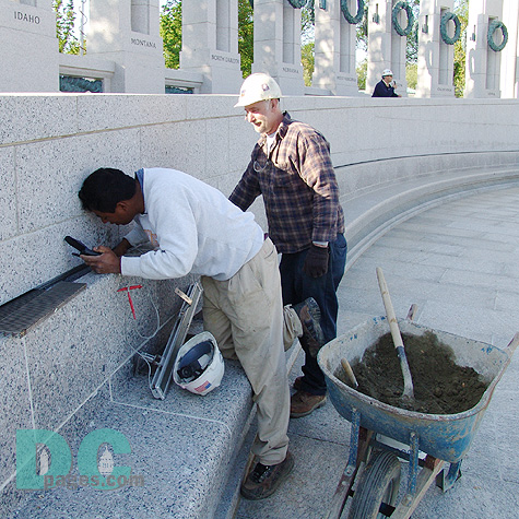 From left to right. Stone Masons, Antonio and John, put the final touches on a drainage system.