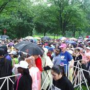 Crowded in the rain, runners patiently wait to begin the race