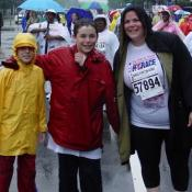 Even soaking wet, a mother and her two sons pose with smiles after finishing the race.