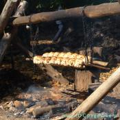 A closeup view of the fire. Roasting chickens are smoke seasoned until they are golden brown.