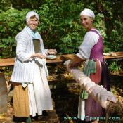 These two women really appreciate the amount of work it took to make a meal in the 18th century.