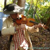 Fiddler, Ted Borek as 'Captian Samuel Slyke' plays a lively tune for the audience. Fiddles were a popular instrument of the time for the lower classes.