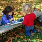 These two children fun painting 18th century prints with water colors.