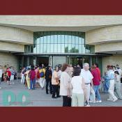 Visitors wait in a long line to enter through the National Museum of the American Indian's East entrance.