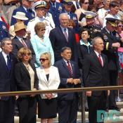 Government leaders watch the ceremony.
