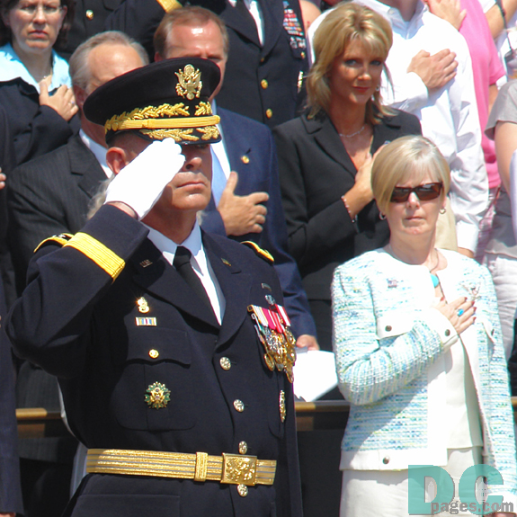 Maj. Gen. Guy C. Swan III, commanding general of U.S. Army Military District of Washington D.C. salutes the the Tomb of the Unknowns. Lynne Pace, wife of Joint Chiefs of Staff U.S. Marine Gen. Peter Pace places hand over her heart in respect.