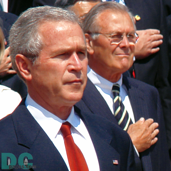 Closeup of President George W. Bush, Secretary of Defense, Donald H. Rumsfeld is in the background.