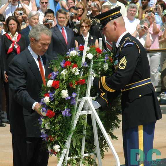 President George W. Bush lays a wreath at the Tomb of the Unknowns during Memorial Day ceremonies at Arlington National Cemetery on May 29, 2006.