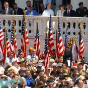 United States veterans hold up our nations flag during the Memorial Day ceremony in Arlington cemetary.