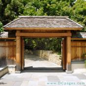 Visitors enter the National Bonsai and Penjing Museum through a Japanese style entrance gate.