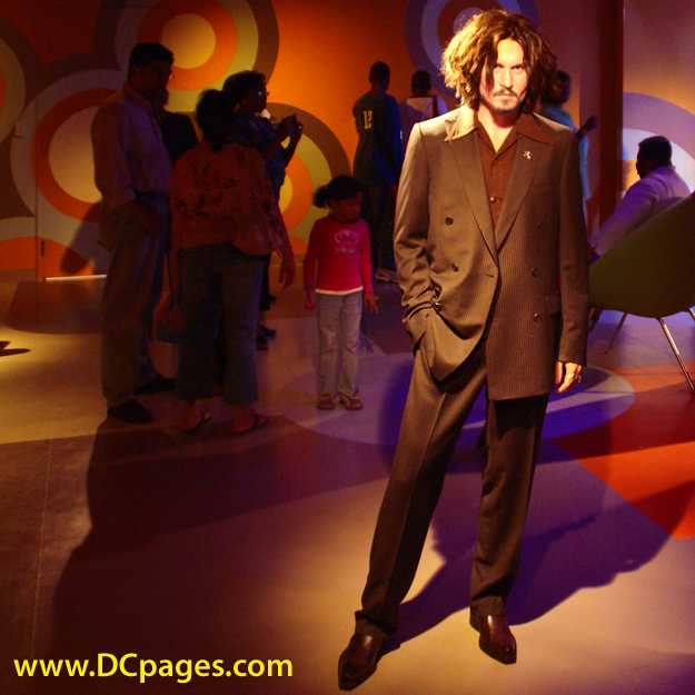 Chic celebrity party - Johnny Depp and his long layered hair style.