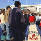 Washington Nationals' Inaugural Home Opener - Many fans were sporting old Washington Senators jackets, jerseys, hats, and other memorabilia. Here a father and son wait in line to attend their first baseball game together.