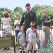 Lieutenant Colonel Bill Solmes with his two sons waiting to pay respects President Reagan.