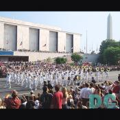The Navy processional marches past the Museum of American History.
