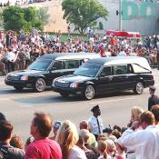 Two hearses lead the President's casket.