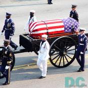 Reagan's casket draped with an American flag proceeds to the U.S. Capitol.