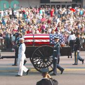 The crowds line the streets to watch the American flag adorned casket proceed by. One detail of the service that weighed heavy on everyone's mind was the actual weight of the casket. Tipping the scales at over 700 pounds, the marble inlayed coffin certainly proved a challenge for the The Old Guard Soldiers.